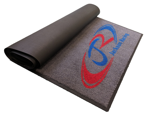 Logo Mat rolled up above
